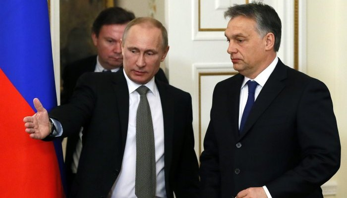 Russia's President Putin shows the way to Hungary's Prime Minister Orban during a meeting at the Novo-Ogaryovo state residence outside Moscow