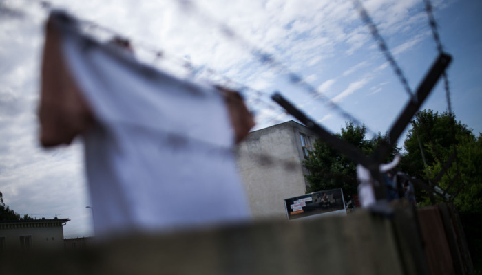 Residents of Debrecen refugee camp - Clothes are hung on the barbed wire fence of the camp / Photo: Márton Magócsi