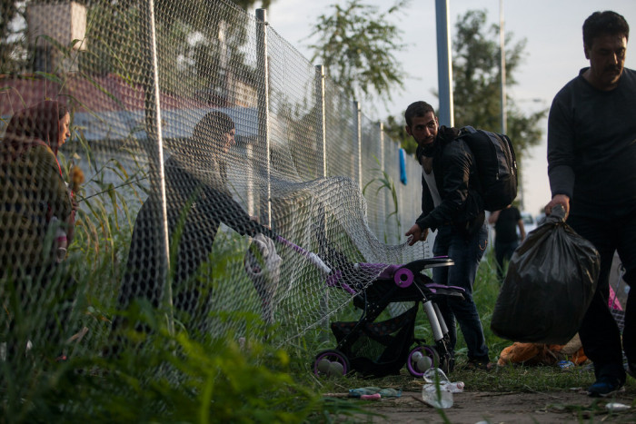 Refugees arriving to Hungary via train track taking a short cut to the border crossing  Photo: Márton Magócsi