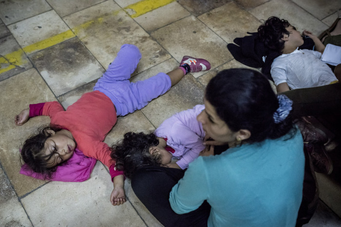 Most of the refugees on the train were from Syrian and Iraq, including a large number of small children.  Photo: D. András Hadjú
