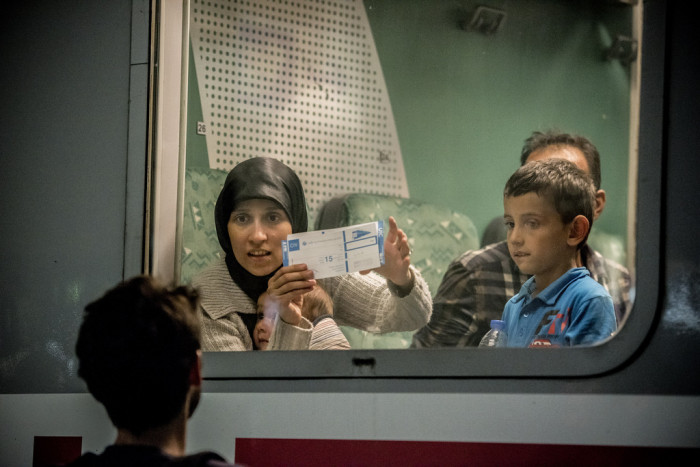 """Everybody wants to go to Germany.  We're afraid there's no more room for us on the train.  Vienna is fine, just so long as we can sleep in peace"" says this Syrian mother.  Photo:  D. András Hajdú"