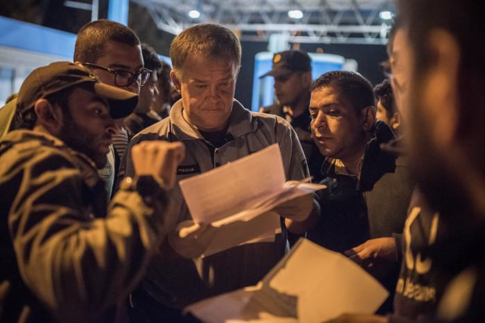 Croatian border guards advise refugees where they can cross into Slovenia.  Photo: D. András Hajdú