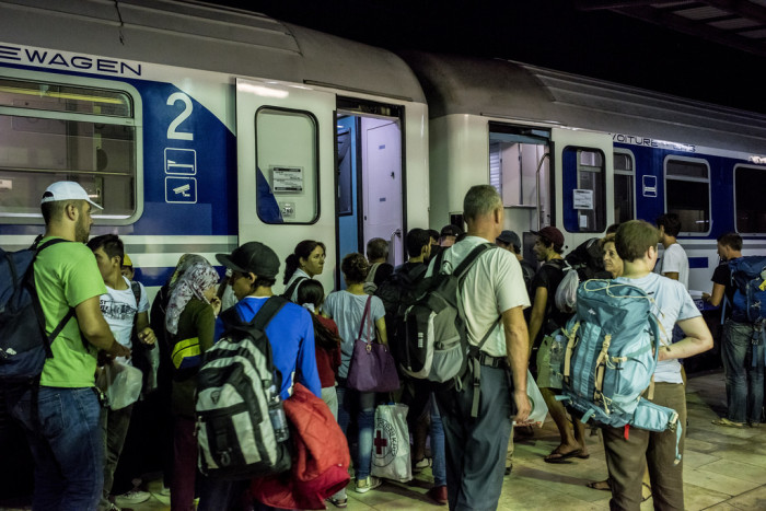 Told they will be no inspection on the Croatian leg of the journey, the refugees board the train for Vienna.  Photo:  D. András Hajdú