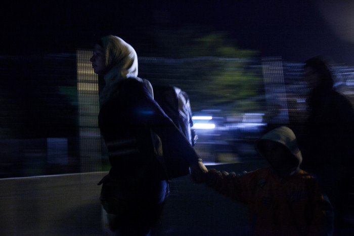 One final group of asylum seekers enters Hungary just before midnight  Photo: Márton Magócsi