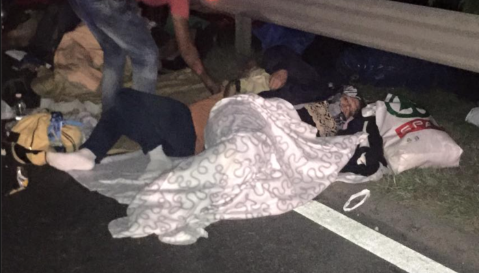 Asylum seekers sleeping by the side of the M1 highway. Photo: Ben Novak