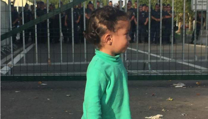 Families with young children prevented from entering Hungary are hungry and cold   Photo: Ben Novak