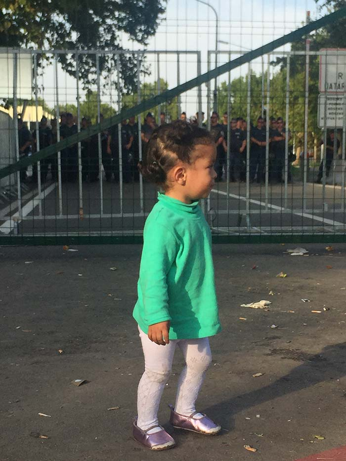 A child standing on the Serbian side of the sealed-off border with Hungary.