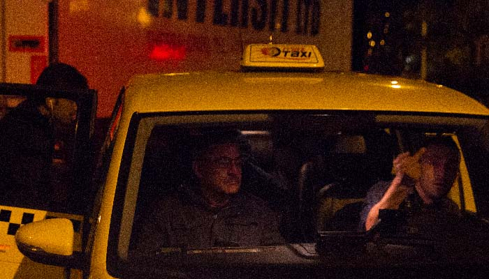 A taxi delivering Syrian refugees to the Hotel Berlin  Photo: Craig Hull