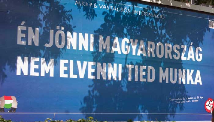 """Billboard parodying the government's xenophobic campaign: """"I to come Hungary not take yours work."""""""
