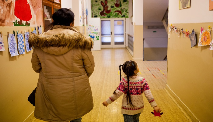 Daniela Kroscenova (27) with her daughter Esther Kroscenova (6) walking in the hall way of ZS Chrustova elementary school to an enrollment examination (test). Esther should be a first class pupil in the school year 2016/2017 in a mainstream school in the city of Ostrava, Czech Republic, where Roma and non Roma children are educated together.