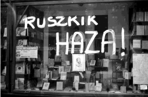 'Russians go home' graffiti on the window of a Russian bookshop, Budapest, November 1956. Foretpan.
