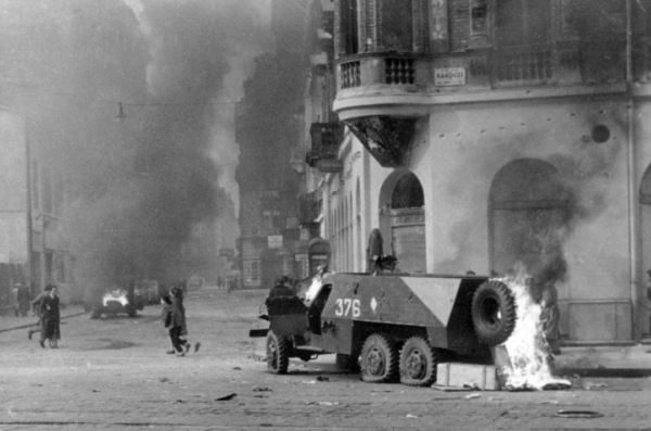 A Soviet armoured car in flames, Budapest, October 1956. Fortepan.